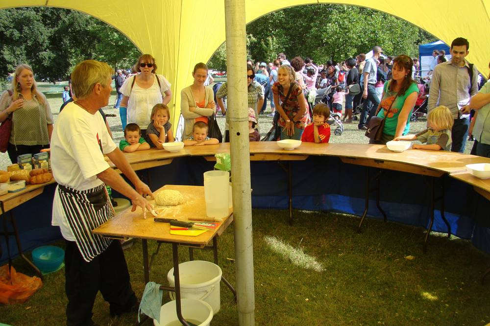 somebody else doing a bakery demo - Lambeth Country show milling 17/7/10, nice setup but then kids creations didn't actually get baked, went in bin. Strange!