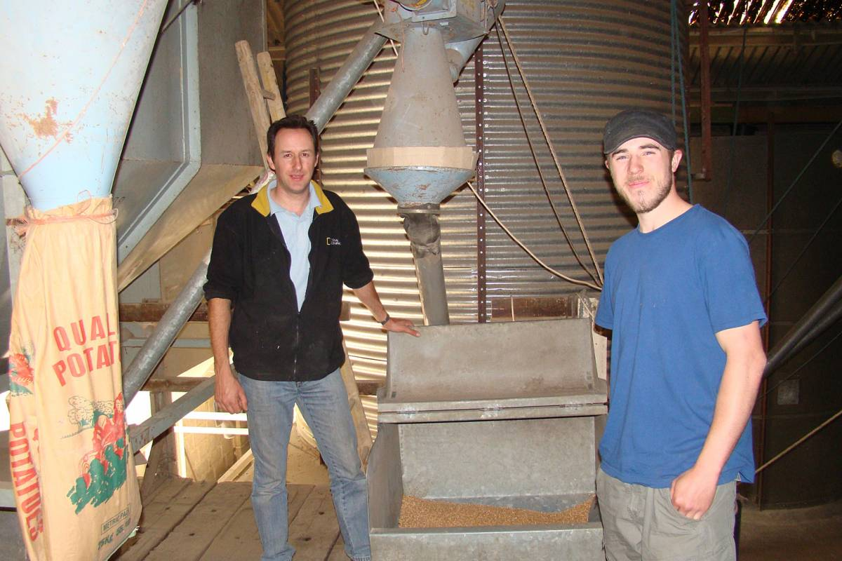 Farmer Leo Brockman and Vince and grain hopper above mill room, visit to Perry Court Farm, nr. Canterbury, Kent 12/5/11