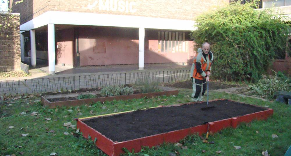 Dave Lukes at work on bed at Lilian Baylis Old School community hub site 12/12/10